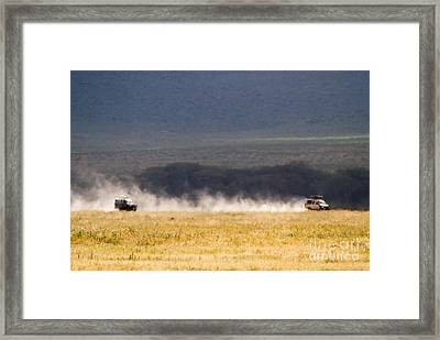 Safari Dust Framed Print by Chris Scroggins
