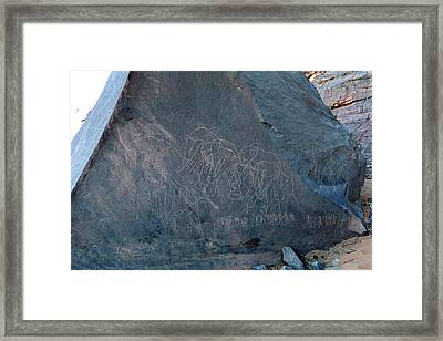 Saharan Elephant Carvings Framed Print by Martin Rietze