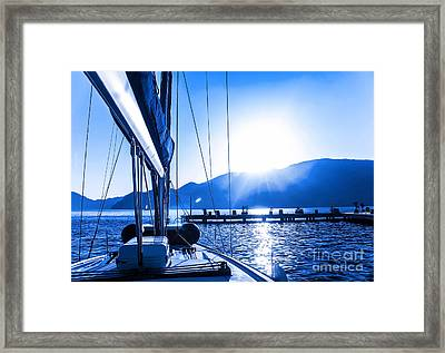 Sail Boat On The Water Framed Print by Anna Om