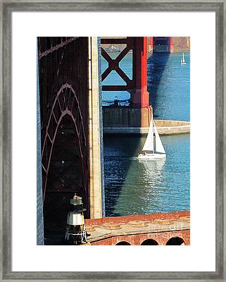 Sail Boat Passes Beneath The Golden Gate Bridge Framed Print