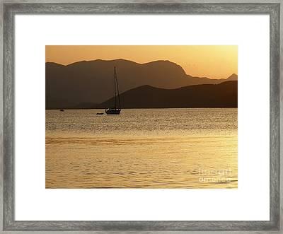 Sailboat At Sunset Framed Print by Sophie Vigneault