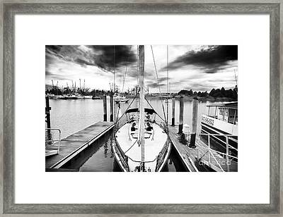 Sailboat Docked Framed Print by John Rizzuto