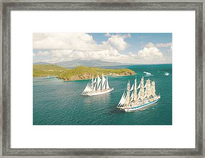 Sailboat Going Out Of Port With Full Sails Up Framed Print by Lanjee Chee