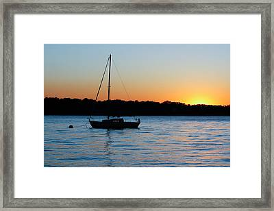 Framed Print featuring the photograph Sailboat Moored At Sunset by Ann Murphy