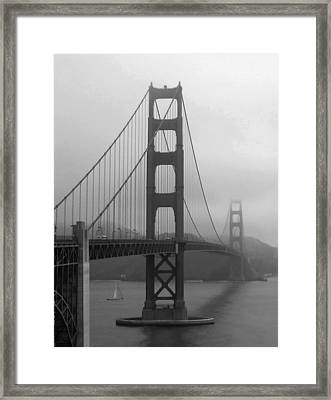Sailboat Passing Under Golden Gate Bridge Framed Print by Connie Fox