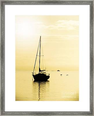 Sailboat With Sunglow Framed Print by Barbara Henry