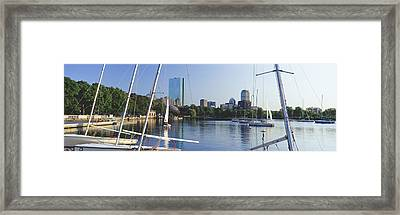 Sailboats In A River With City Framed Print by Panoramic Images