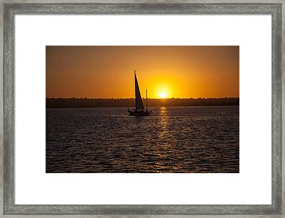 Sailing At Sunset Framed Print by Margaret Buchanan