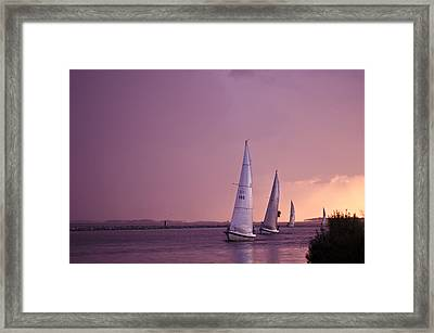 Sailing From The Sun Framed Print by Kelly Reber
