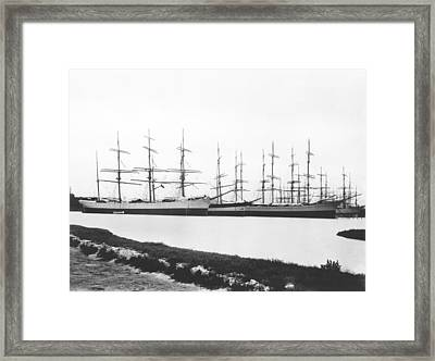 Sailing Ships In A Harbor Framed Print by Underwood Archives
