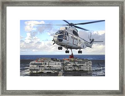 Sailors  Attach Cargo Legs To An Sa330j Framed Print