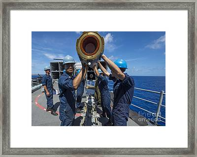 Sailors Load Rim-7 Sea Sparrow Missiles Framed Print by Stocktrek Images