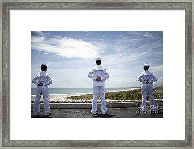 Sailors Man The Rails As The Ship Pulls Framed Print by Stocktrek Images