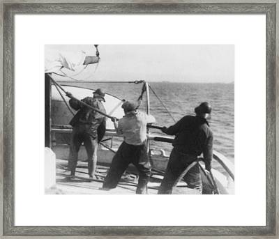 Sailors Pulling Rope Framed Print by Underwood Archives