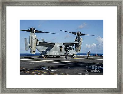 Sailors Run To Safety After They Chock Framed Print by Stocktrek Images