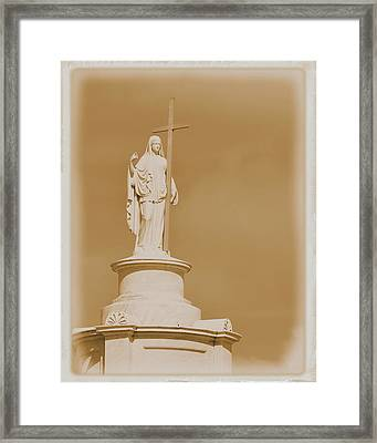 Framed Print featuring the photograph Saint With A Cross by Nadalyn Larsen