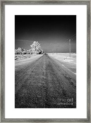 salt and grit covered rural small road in Forget Saskatchewan Canada Framed Print