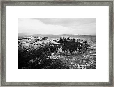 Salt Pan Rocks At Ballycastle Beach With Rathlin Island In The Background In Winter County Antrim Northern Ireland Framed Print by Joe Fox