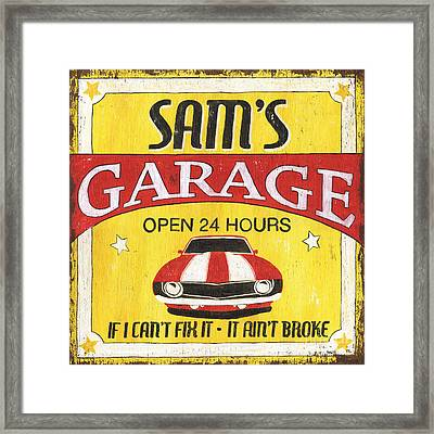 Sam's Garage Framed Print