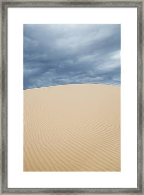 Sand Dunes And Dark Clouds Framed Print