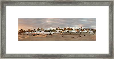 Sand Dunes In A Desert With A Hotel Framed Print by Panoramic Images