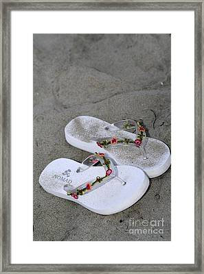 Sandals In The Sand Framed Print by Laura Paine
