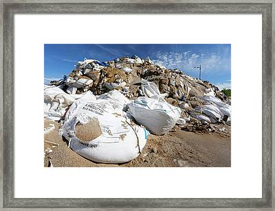 Sandbags In A Port After Flooding Framed Print by Michael Szoenyi