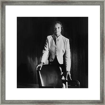 Sandra Day O'connor Posing Beside An Office Chair Framed Print by Horst P. Horst