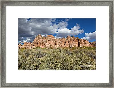 Sandstone And Clouds In Zion Natl Park Utah Framed Print by Yva Momatiuk John Eastcott