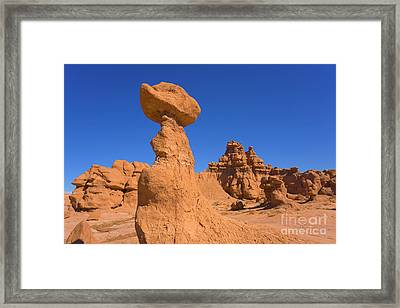Sandstone Hoodoos In Goblin Valley  Framed Print by Yva Momatiuk John Eastcott