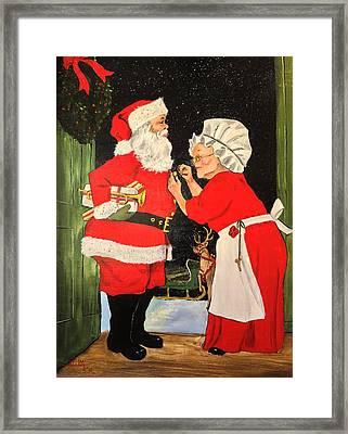 Santa And Mrs Framed Print