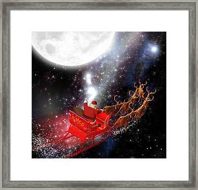 Astronaut Santa Delivering Presents Framed Print by Doc Braham