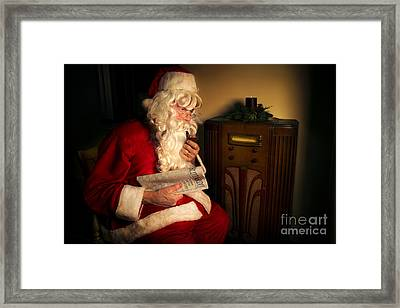 Santa Listening To The Weather Report Framed Print by Diane Diederich