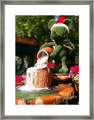 Framed Print featuring the photograph Santa Mickey Topiary Fountain by Doug Kreuger