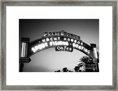 Santa Monica Pier Sign In Black And White Framed Print by Paul Velgos