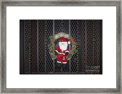 Santa On A Metal Grate Framed Print by Thomas Marchessault