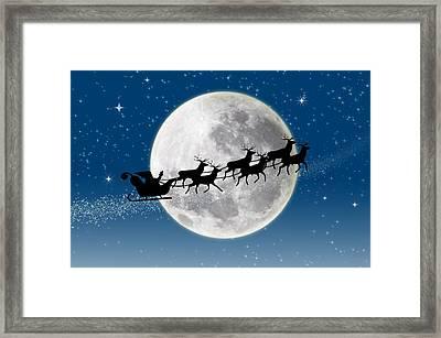 Santa Over The Moon Framed Print by Doc Braham