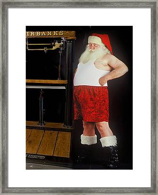 Santa Scaling Back Framed Print