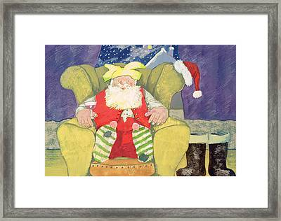 Santa Warming His Toes  Framed Print by David Cooke