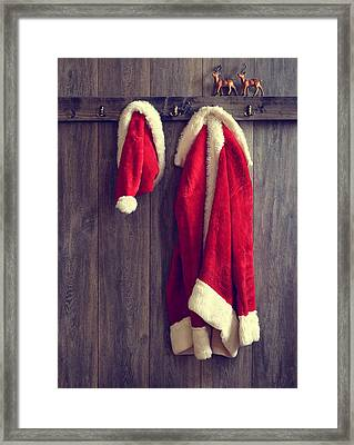 Santa's Hat And Coat Framed Print by Amanda Elwell