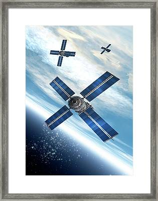 Satellites Orbiting The Earth Framed Print by Victor Habbick Visions