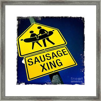 Sausage Crossing Framed Print by Nina Prommer