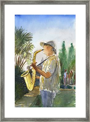Sax In The Park Framed Print