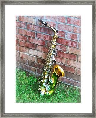 Saxophone Against Brick Framed Print by Susan Savad