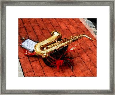 Saxophone Before The Parade Framed Print