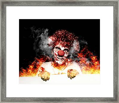 Scary Clown Holding Blank Board In Flames And Fire Framed Print by Jorgo Photography - Wall Art Gallery