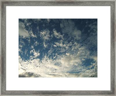 Scattered Clouds Framed Print by Margaret McDermott