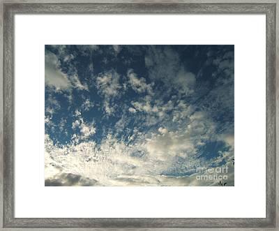 Scattered Clouds Framed Print by Margaret McDermott
