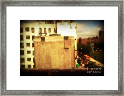 School Bus With White Building Framed Print by Miriam Danar