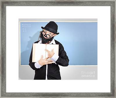 School Teacher In Classroom Pointing To Empty Book Framed Print